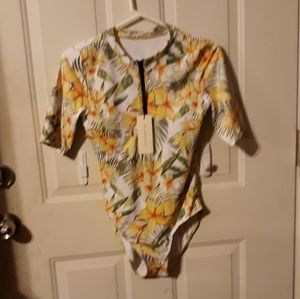 Righr size small flowered NWT bodysuit. Smoothing.